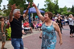 TIMES FILE PHOTO - Quirio and Donna Alrcon Elizondop of Tualatin dance at a summer concert on the Tualatin Commons last year. Both Tigard and Tualatin already promote citizen recreation, says Tualatin Mayor Lou Ogden, who thinks it makes sense for the cities to apply jointly to become a 'Blue Zones' demonstration site.