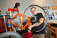 CLACKAMAS REVIEW: JOHN DENNY -  James Emond, owner of the Missing Link, installs a chain on a custom-built adventure bike he is assembling for a customer who plans to tour the Oregon Coast. Its got a rugged and sturdy Soma Wolverine frame that is built to accommodate luggage racks, Emond says.