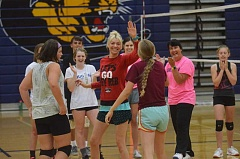 HERALD PHOTO: COREY BUCHANAN - The Cougars congratulate a Canby volleyball player after a point during the final day of the Canby volleyball camp Wednesday, Aug. 10.
