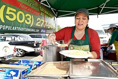 TIMES FILE PHOTO - La Popular has served Mexican foods at the Aloha Community Farmers' Market, which began this year in a parking lot off Southwest Kinnaman Road.
