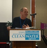 SUBMITTED PHOTO - Clackamas County Water Environment Services Director Greg Geist accepts the award at last month's conference of the Oregon Association of Clean Water Agencies.