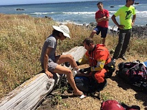 COURTESY OF SCOUT TROOP 859 - Dawn Nakano of San Franciso, left, (above photo) has a bandage rewrapped by a U.S. Coast Guard airman as Scout leaders Joe Young (red shirt) and Anthony Holden look on.