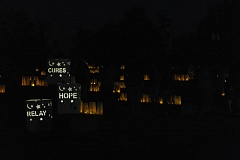 SPOKESMAN PHOTO: CLAIRE COLBY - More than 100 luminaria light the fountain at Town Center Park Aug. 19 for the 2016 Relay for Life.