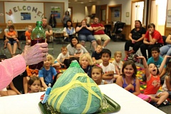 PHOTO: WILSONVILLE PUBLIC LIBRARY - Children participating in the 2016 Summer Reading Program gather around a Science Exploration demonstration at the Wilsonville Public Library, earning a sticker for their Science Exploration logs.