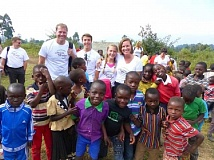 SUBMITTED PHOTO - Lake Oswego residents Chris and Joy Rich and their children, Grace and Gus, visited Tanzania in late July and early August to see the impact of Africa Bridge firsthand. Through its efforts, the nonprofit has helped lift 28 villages out of the cycle of poverty.