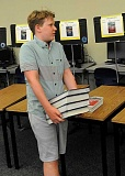 REVIEW PHOTO: VERN UYETAKE - Reese Dennett gathers his books during freshmen
