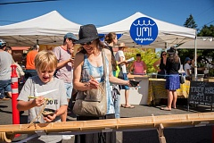 SHAWN LINEHAN - The 'noodle luge' at King Farmers Market in Northeast Portland last month delighted fans of all ages as they tested their prowess with chopsticks and learned about Umi Organic at the same time.