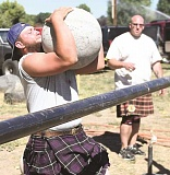 LON AUSTIN/CENTRAL OREGONIAN - Prineville resident Daniel Keffer works to lift a 182-pound ball over a bar in the stones over bar competition, which was held at the conclusion of Saturday's Highland Games. The games were put on by the Bald Mountain Knuckle Draggers from Mountain Home, Idaho.