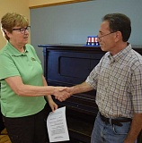 DANIEL PEARSON  - Mayor Deborah Rogge welcomes Glen Boreth to the Molalla City Council last Wednesday.