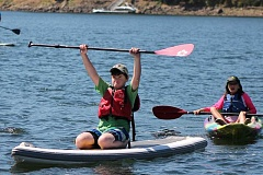 SPOKESMAN PHOTO: ANDREW KILSTROM - Rosemont Ridge sixth-grader Nolan Price triumphantly approaches the eNRG dock on his paddle board Aug. 24.