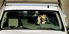 FILE PHOTO - The base fine for talking on your cellphone while driving is $160.