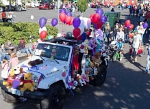 CONTRIBUTED PHOTO - The Teddy Bear Parade attracts stuffed animal enthusiasts of all ages and often features vehicles like this one,  festooned with bears and balloons.