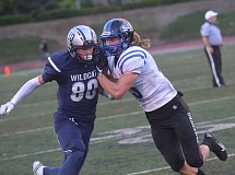 SPOKESMAN PHOTO: COREY BUCHANAN - Wilsonville receiver Harrison Steiger tries to break free from South Medford defensive back Chase Coda.