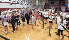 BARBARA SHERMAN - As the Sherwood High School band plays pulsating music, members of the district's staff plus guests walk into the gymnasium to take their seats in the bleachers for a back-to-school message from district leaders.