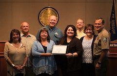 PHOTO COURTESY: CCSO - Clackamas County commissioners join A Safe Place staff members and Sheriff Craig Roberts (right) in celebrating the award.
