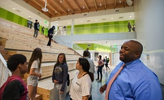 OUTLOOK PHOTO: JOSH KULLA - Open School East Principal Matt Ross chats with students in the light-filled atrium space where the entire school can gather for meetings, lectures or rallies.