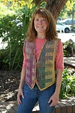 SPOKESMAN PHOTO: CLAIRE COLBY - Inspired by the natural world, weaver Marlene Lloyd is thrilled to share her handwoven textiles with the Wilsonville Public Library during the month of September. (Pictured wearing her piece Illusions of Color)