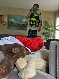 SUBMITTED PHOTO - During the summer, Lakeridge High School junior Ava Eucker was a babysitter for this kiddo, who is wearing his Octoman costume and about to dive into a huge pile of pillows and stuffed animals.