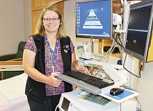 HOLLY M. GILL - Tammy Wilson, the birthing center manager at St. Charles Madras, displays the fetal heart monitor and computer documenting system that is found in each of the five labor rooms.