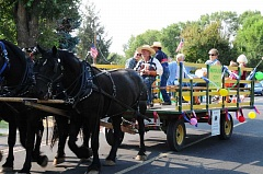 BILL VOLLMER - The Metolius City Council rides in a wagon during last year's Spike and Rail Parade. This year's event is set for Saturday, Sept. 10.