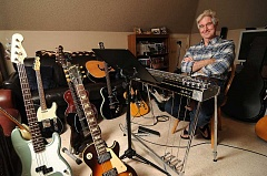 STAFF PHOTO: VERN UYETAKE - Mark Bonney looks like the master of the musical universe in the studio at his Lake Oswego home.