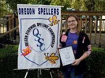 PHOTO COURTESY OF MARTY GIOVANNINI - Jenna Porter, who recently completed eighth grade at Crook County Middle School, traveled to the Oregon State Fair in Salem last Saturday to compete in the Oregon Statewide Spelling Championship. She earned third place in the sixth through eighth grade division, scoring $25 and a framed certificate.