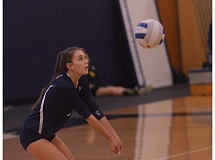 SPOKESMAN PHOTO: COREY BUCHANAN - Wilsonville defensive setter Kathryn Williams bumps the volleyball against Milwaukie.