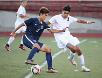 REVIEW/NEWS PHOTO: JIM BESEDA - Westview's Takumi Jankovsky (15) tries to maneuver around Oregon City's Anthoni Bautista during the first half of Thursday's non-conference boys' soccer match at Pioneer Memorial Stadium.