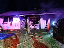 CLACKAMAS FIRE DISTRICT #1 -  Three people were hospitalized when this house in the 6500 block of Hemlock Street in Milwaukie was damaged by fire Sunday.
