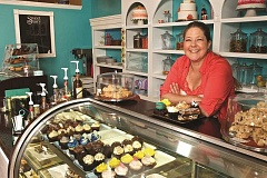 GAZETTE FILE PHOTO: JAIME VALDEZ - Michele R. Howard, shown here at SweetStorys former location on Railroad Street, to the former Lavender Tea House more than two years ago. She is closing the business to spend more time with her growing boys.