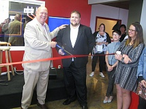 PHOTO BY RAYMOND RENDLEMAN - Martin Rafferty, executive director of Youth M.O.V.E. Oregon, cuts the ribbon on the renovated Milwaukie facility with help from John Ludlow, chairman of the Board of County Commissioners.