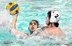 SETH GORDON - Josh Passmore fends off a defender en route to one of his eight goals in Newberg's 13-5 victory over Southridge Sept. 6 at the Chehalem Aquatic Center.