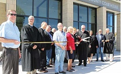 HOLLY GILL/MADRAS PIONEER - Presiding Circuit Court Judge Daniel Ahern and Court Administrator Amy Bonkosky cut the ribbon Friday during the dedication ceremony for the new Jefferson County Courthouse. The new facility was built for $14 million, $1 million less than was budgeted.