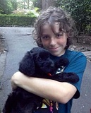 SUBMITTED PHOTO - In one of the last photos taken of him by his mom, 11-year-old Thomas Graham holds his Giant Schnoodle puppy, Cody. Graham died in December 2014 after a tree toppled onto the car being driven by his mom in a windstorm.
