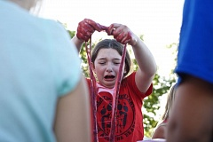 TIMES PHOTO: JAIME VALDEZ - Abby Beers, 11, reacts after handling slime that she made in a STEM activity at a back-to-school event at Tualatin Elementary School. Beers attended the event with her younger sister, Libby, who is a third-grader at the school.