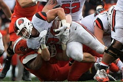 TRIBUNE PHOTO: JOSH KULLA - Ryan Nall carries for Oregon State against Idaho State