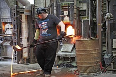 COURTESY OF CASSANDRA PROFITA, OPB/EARTHFIX - A worker at Bullseye Glass, which makes artistic and architectural colored glass in Southeast Portland. The company has agreed to halt its use of arsenic, cadmium and chromium after carcinogenic levels of emissions were detected near its Southeast Portland plant.