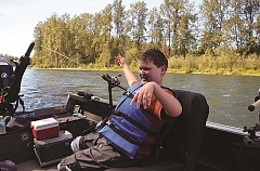 PHOTO COURTESY OF YOUTH OUTDOORS UNLIMITED  - Sean Derrick smiles from his seat on the boat as it travels along the Cowlitz River in Washington state for his YOU fishing trip.