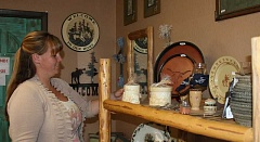 HOLLY SCHOLZ/CENTRAL OREGONIAN - Kami Dunlap opened Country Life Reride in June, a shop featuring new and used country goods. She offers consignment services and specializes in home decor, horse tack, clothing and gifts with a Western flair.