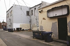INDEPENDENT PHOTO: LARRY COONROD - This alleyway between Lincoln and Grant streets is one of three in the downtown area that Woodburn City Council would like to clean up by enclosing Dumpsters, adding security lighting and putting in landscaping.