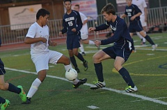 HERALD PHOTO: COREY BUCHANAN - Canby boys soccer player Leonardo Zamora jostles for the ball with a West Albany player.