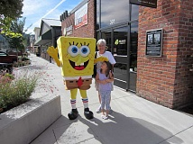 CONTRIBUTED PHOTO: MICHELE JONES - Sue Klaetsch and her granddaughter Ellie Youngberg meet Spongebob Squarepants at a customer appreciation event organized by Reliance Connects on Friday, Sept. 16