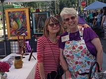 ESTACADA NEWS FILE PHOTO - Nina Bradford and Sue Dumolt smile at the Spiral Gallery's booth at Estacada Uncorked in June. The event was recently recognized by the Oregon Main Street Program.
