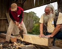 SUBMITTED PHOTO  - Restore Oregon will host its annual Heritage Barn workshop Oct. 1 at Donald Manson Barn at Champoeg State Park. Hewing demonstrations are part of the educational program.