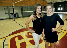 GRAPHIC PHOTO: SETH GORDON - George Fox University students Sierra McNeil and Codi Morton volunteered on short notice to take over coaching duties with the C.S. Lewis volleyball team after coach Meeka Mayhew abruptly stepped down.