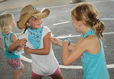 TIDINGS PHOTOS: VERN UYETAKE - Ellis Highland, left, and Chloe An dance up a storm at the Stafford Stampede Sept. 16.