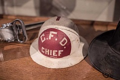 NEWS-TIMES PHOTO: CHASE ALLGOOD - An old Cornelius fire chief hat is among several artifacts included from the citys early firefighting equipment.