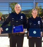 CONTRIBUTED PHOTO - Gresham Police welcome its two newest academy graduates, officers Jonathan Slack and Dana Gunnarson.