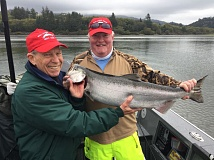 Bob Keerins (right) and Tack Goddell of Portland with a Tillamook Bay Fall Chinook from September 19.