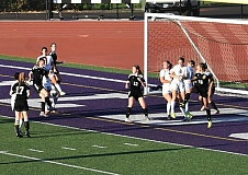 PHOTO CREDIT: LESLIE LUTTRELL - Lions freshman forward Kelsey Elliott (7) scored a game winner off of a Sophia Estep cross with six seconds left to beat Hermiston 2-1 on the road.